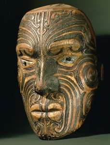 A carved wood Maori head with inlaid shell eyes. It represents a specific ancestor, who can be recognised by his distinctive pattern of moko, facial tattoos. These tattoos were a sign of great courage and regarded as revealing a man's true identity. Country of Origin: New Zealand. Culture: Maori. Material Size: Wood, shell. Credit Line: Werner Forman Archive/ Auckland Institute and Museum, Auckland. Location: 09.