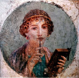 "Portrait of a girl, previously thought to represent Sappho the ancient Greek poetess, with tablets and pen. She is also known as ""Meditation"". Country of Origin: Italy. Culture: Roman. Date/Period: c 75 AD. Place of Origin: Pompeii. Material Size: Fresco, diameter 29cm. Credit Line: Werner Forman Archive/ Museo Archeologico Nazionale, Naples, Italy. Location: 07."