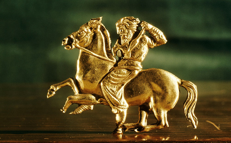 """Plaque in the form of a Scythian horseman brandishing a spear. Country of Origin: Russia. Culture: Scythian. Date/Period: 4th century BC. Place of Origin: Kul Oba. Material Size: Gold 1.5""""x 2"""". Credit Line: Werner Forman Archive/ Hermitage Museum, St Petersburg."""