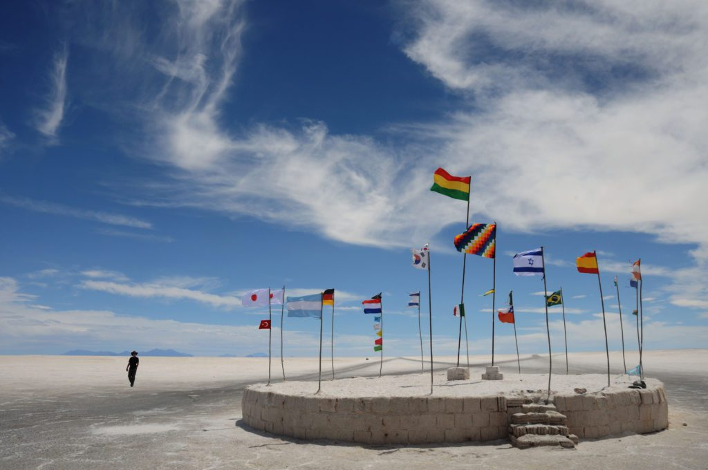BYHP1A International flags flying in the Salar de Uyuni, Bolivia