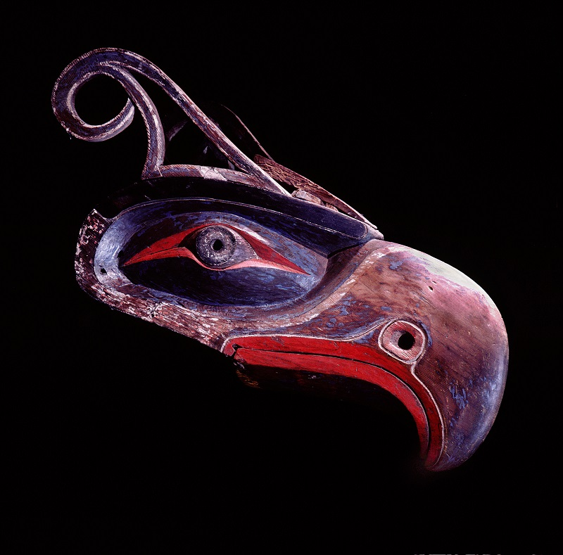 "Thunderbird headdress identified by its down-turned beak and feathered horns. The thunderbird appears in the sacred """"Tsayeka"""" or red cedarbark dance series. It was thought to cause thunder when it flapped its wings and lightning when it flashed its eyes. Country of Origin: Northwest Coast of America Culture: Kwakiutl. Date/Period: collected 1920 at Alert bay. Material Size: wood. Credit Line: Werner Forman Archive/ Museum of Anthropology, University of British Columbia, Vancouver. Location: 29."