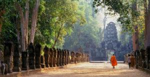 Cambodia: A monk walks towards the western gopura, Preah Khan, Angkor © David Henley / Pictures From History