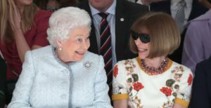 Queen Elizabeth II sits next to Anna Wintour (right) as they view Richard Quinn's runway show before presenting him with the inaugural Queen Elizabeth II Award for British Design ©Yui Mok/PA Wire