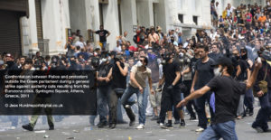 Confrontations between police and protesters outside the Greek parliament during a general strike against austerity cuts. Syntagma Square, Athens, Greece. © Jess Hurd/reportdigital.co.uk