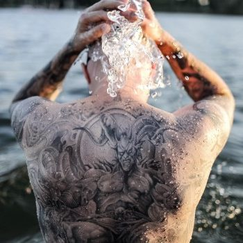 Close-Up Of Man In Lake - Creative #:748351815 Stanislav Simtsenko / EyeEm / Getty Images