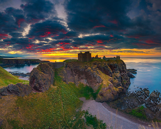 United Kingdom, Scotland, Aberdeenshire, Stonehaven, Dunnottar Castle, Great Britain, British Isles, Colorful sunrise on Dunnottar castle along the Scotland coastline