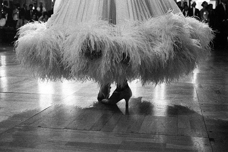 Feathers. Low angle view of a ballroom dancer's feathered hem. This photograph was featured in the exhibition 'The Ballroom Spy' in collaboration with artist Jack Vettriano which transferred from Heartbreak, London to the Royal West of England Academy in Bristol in 2011.