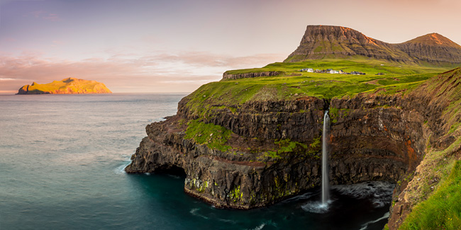 Denmark, Faeroe Islands, Vágar, Scandinavia, Gasadalur, the iconic waterfall jumping from the cliff into the ocean