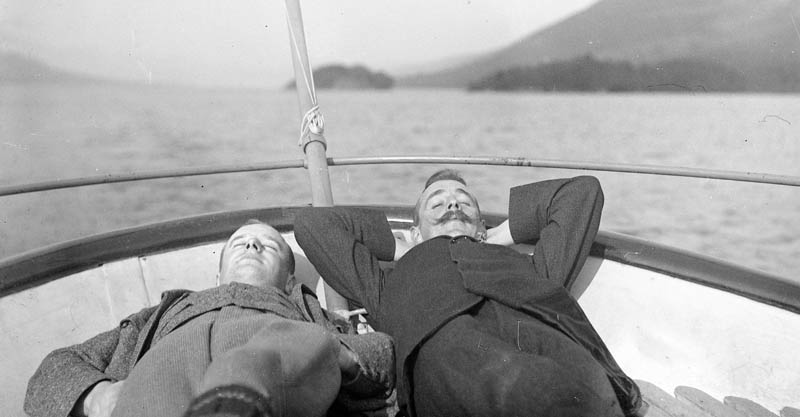 Wilson and Nelstrop asleep on a boat on Coniston, Lake District, or more likely pretending to sleep - another photograph giving the lie to Edwardian conformity. Date: circa 1907