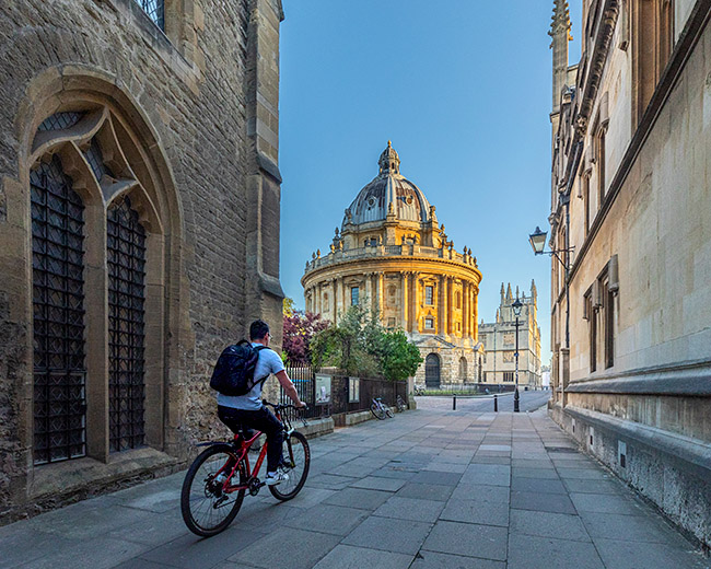 United Kingdom, England, Oxfordshire, Oxford, cyclist approaching Radcliffe Camera