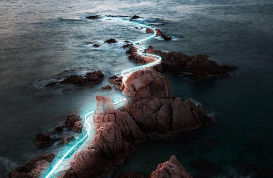 Light painting between the rock formations in the Costa Brava coastline.