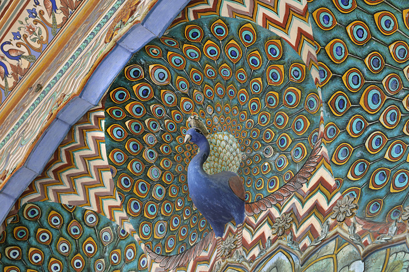Peacock Gate, detail, with motifs of peacocks, representing autumn and dedicated to Lord Vishnu, the North East gate of the Pritam Niwas Chowk or inner courtyard, in the City Palace, built 1727-32 by Maharaja Sawai Jai Singh, founder of Jaipur, as the seat of the maharaja of Jaipur, designed by Vidyadhar Bhattacharya and Sir Samuel Swinton Jacob, mixing European, Mughal and Rajput architectural styles, in Jaipur, Rajasthan, India. The building now houses the Maharaja Sawai Man Singh II Museum, and is the home of the Jaipur royal family. The city of Jaipur was founded in 1727 by Jai Singh II, the Raja of Amer, and planned and designed by Vidyadhar Bhattacharya. Jaipur is the capital of Rajasthan and the 10th most populous city in India. Jaipur is listed as the Pink City of India UNESCO World Heritage Site. Picture by Manuel Cohen