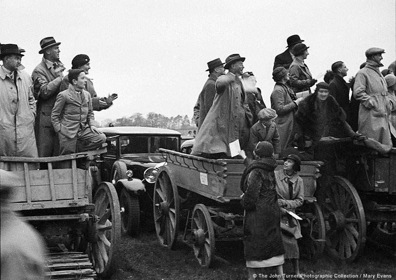 Race-goers caught up in the excitement of the moment. Date: circa 1930s