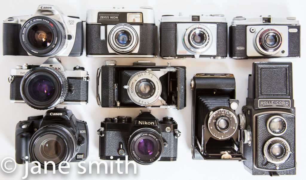 a collection of analog cameras