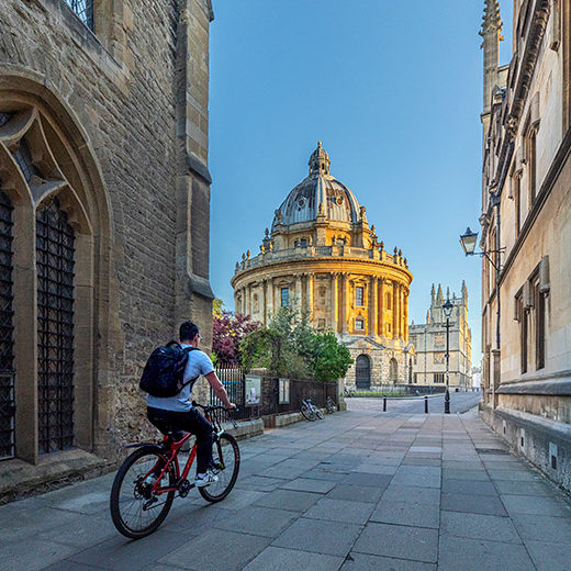 United Kingdom, England, Oxfordshire, Oxford, cyclist approaching Radcliffe Camera